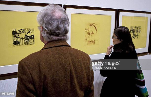 Visitors watch pieces of the Volpiniserie on February 17 2010 in Amsterdam The Van Gogh Museum in Amsterdam shows works of French paintor Paul...