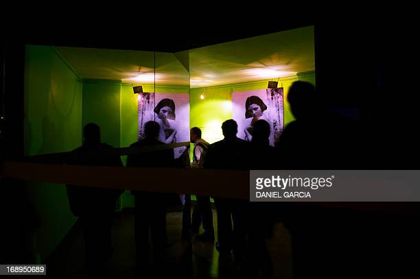 Visitors watch portraits of Eva Duarte de Peron Evita when she was young displayed at the main hall of the Evita Museum in Buenos Aires on May 16...