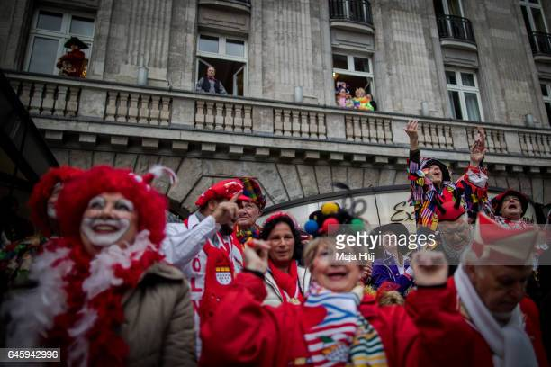 Visitors watch Rose Monday parade on February 27 2017 in Cologne Germany Political satire is a traditional cornerstone of the annual parades and the...