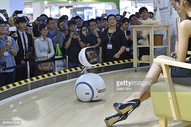 Visitors watch the ASUS Zenbo robot during the annual Computex computer exhibition on May 31 2016 More then 5000 booths from thirty countries take...
