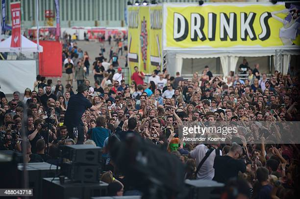 Visitors watch the Beatsteaks concert during the second day of the Lollapalooza Berlin music festival at Tempelhof Airport on September 13, 2015 in...