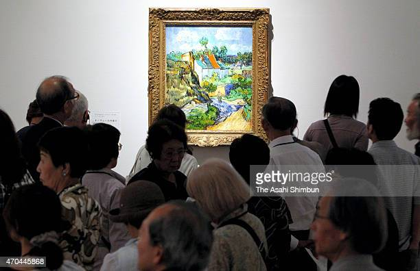 Visitors watch the Houses in Auvers by Vincent van Gogh during the Museum of Fine Arts Boston exhibition at Kyoto Municipal Museum of Art on July 5...