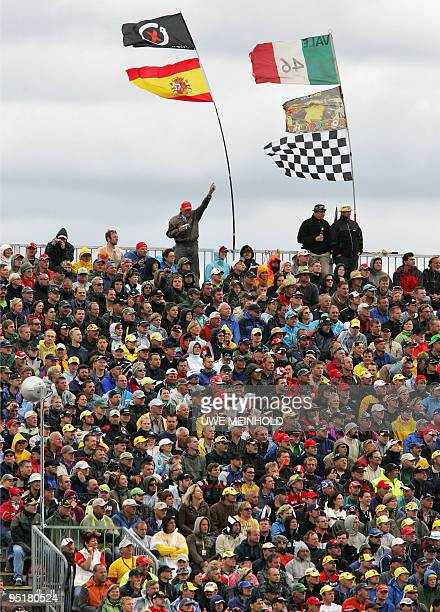 Visitors watch the Moto GP race at the German Grand Prix meeting on July 19 2009 at the Sachsenring in HohensteinErnsttahl eastern Germany Rossi won...