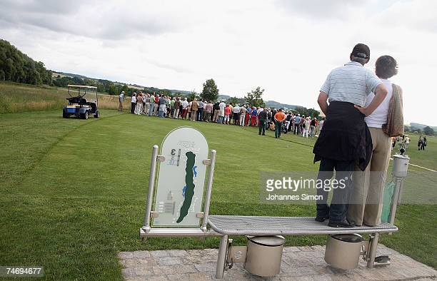 Visitors watch the opening of Hartl Golf Resort from outside on June 18 in Penning Germany