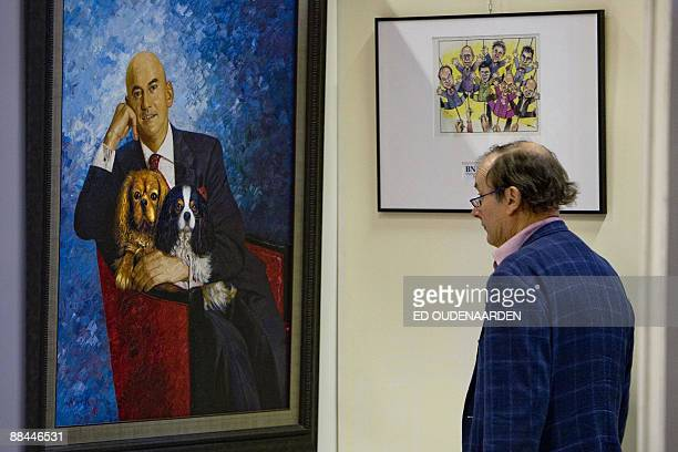 Visitors watch the possesions of late politician Pim Fortuyn at the Hessink's auctions in Nijmegen on June 12 2009 The possesions of Fortuyn will be...