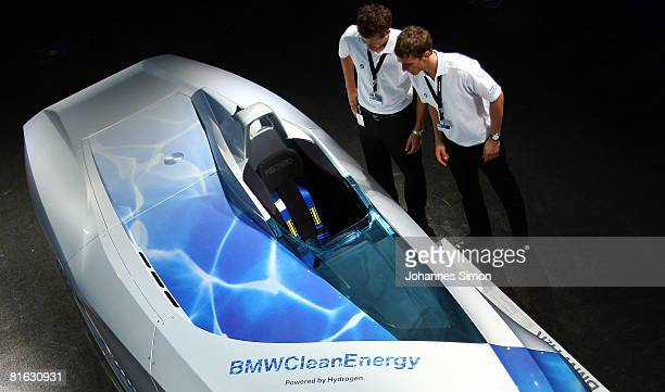 Visitors watch the prototype of a BMW H2R racing car after the reopening of the redesigned BMW car museum on June 19 2008 in Munich Germany The so...
