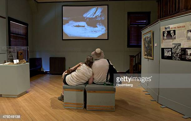 Visitors watch vintage video footage of a boat on the Colorado River in a gallery at the Kolb Studio in the Grand Canyon Village area of the National...