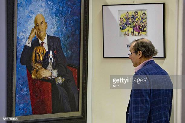 A visitors watches a painting depicting late Dutch far right politician Pim Fortuyn at the auction Hessink's in Nijmegen on June 12 2009 An...