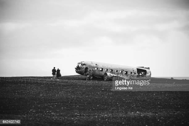 Visitors watching Plane Wreck on black beach, Iceland