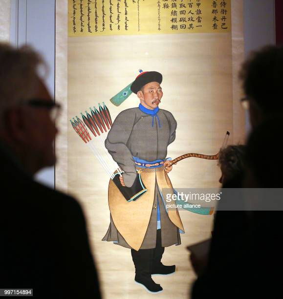 Visitors watching portrait paintings from China depicting a garde officer in the Kulturforum at the Matthaikirchplatz in Berlin Germany 10 October...