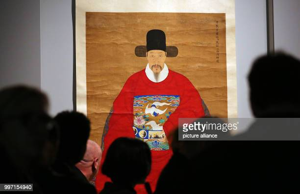 Visitors watching portrait paintings from China in the Kulturforum at the Matthaikirchplatz in Berlin Germany 10 October 2017 The exhibition 'Faces...