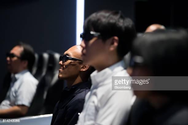 Visitors wear 4D glasses during a presentation at the Hyundai Motor Co Motorstudio showroom in Goyang South Korea on Friday July 14 2017 Hyundai...