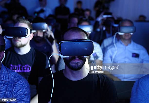 Visitors wear Gear VR 4D Experience headsets with the Galaxy Note 7 smartphone during a Samsung Electronics Co 'Unpacked' launch event in London UK...