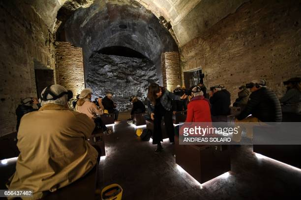Visitors wear special 3D viewing devices in a room of the Domus Aurea a large palace built by the Roman Emperor Nero in the first century during a...