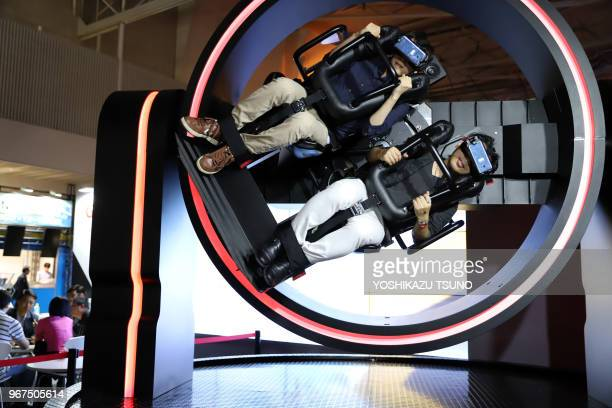 Visitors wearing 3D goggles try to play a virtual reality video game at the Tokyo Game Show 2017 in Chiba, suburban Tokyo on September 21 Japan.