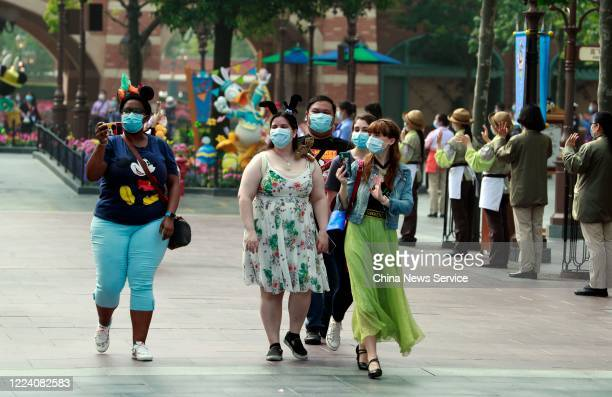 Visitors wearing face masks are seen at Shanghai Disney Resort after the coronavirus pandemic on May 11 2020 in Shanghai China Walt Disney Co...