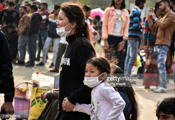 Visitors wearing face masks following the novel coronavirus outbreak India reported its first case of novel corona virus putting the focus on the...