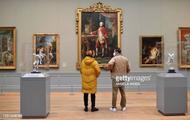 Visitors wearing facemasks look at paintings at The Metropolitan Museum of Art, 'The Met' in New York City on February 9, 2021.