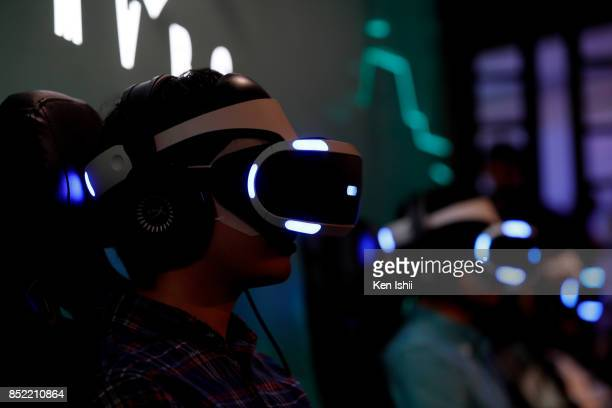 Visitors wearing VR headset play the Anubis Mars video game in the Konami Holdings Corp booth during the Tokyo Game Show 2017 at Makuhari Messe on...