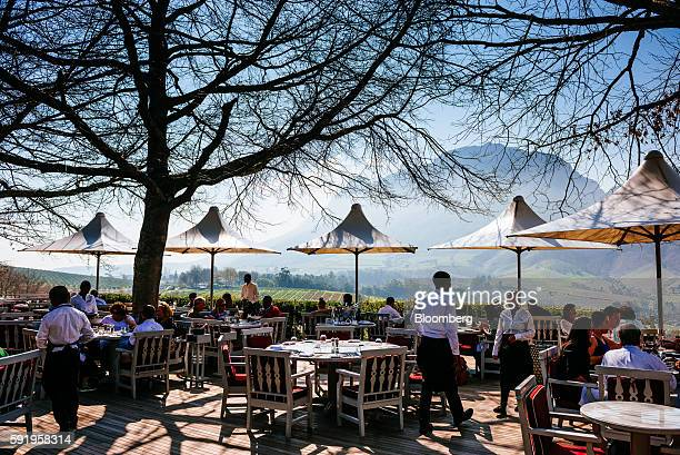 Visitors wine and dine on the outdoor restaurant terrace at the Delaire Graff Estate in Stellenbosch South Africa on Thursday Aug 18 2016 Billionaire...