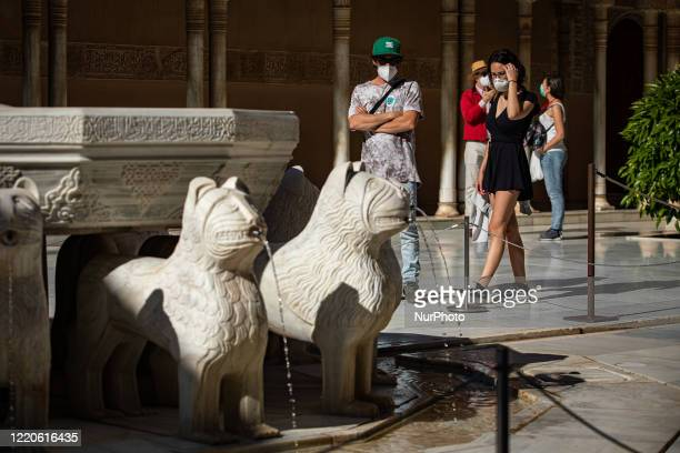 Visitors with face masks seen in the Court of The Lions during the reopening day of the Alhambra and all its palaces with prevention measures to...