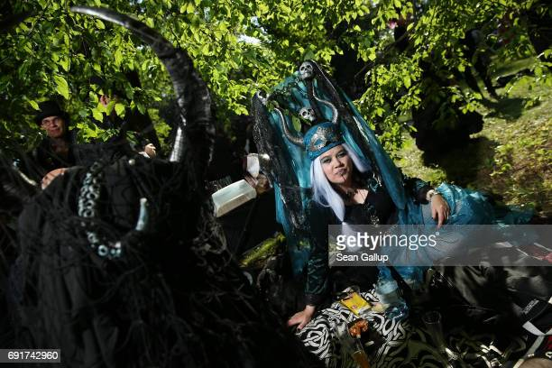 Visitors with horned headgear relax at their picnic blanket as they attend the Victorian Picnic on the first day of the annual WaveGotikTreffen Goth...