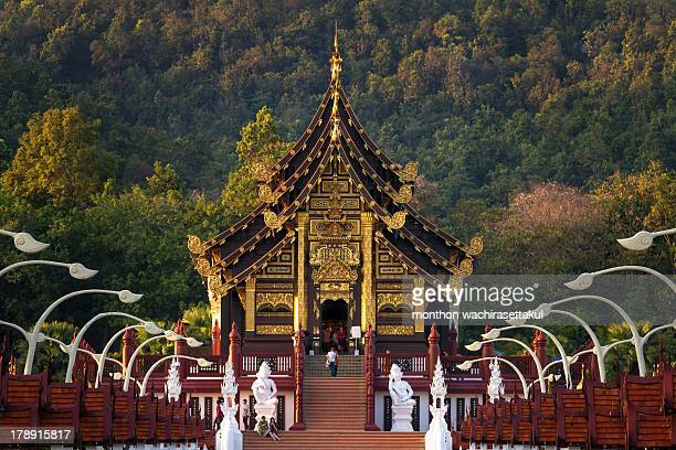 Visitors within the building Traditional thai architecture in the Lanna style , Royal Pavilion at Royal Flora Expo, Chiang Mai, Thailand 28 December...