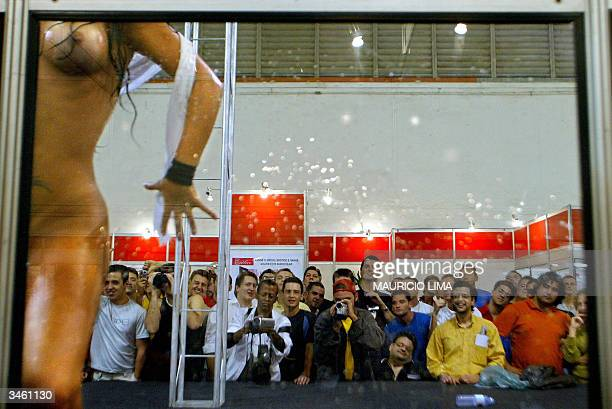 Visitos watch a striptease show during Erotika Fair in Sao Paulo Brazil late 21 April 2004 The event the biggest of its kind in Latin America and...