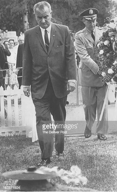 MAY 28 1964 Visits Kennedy Grave President Johnson stands in front of the eternal flame at the gravesite of John F Kennedy after placing a wreath...