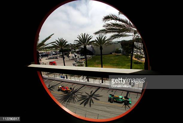 J Viso driver of the Racing Technology Lotus Dallara Honda drives during the IndyCar Series Toyota Grand Prix of Long Beach on April 17 2011 in Long...