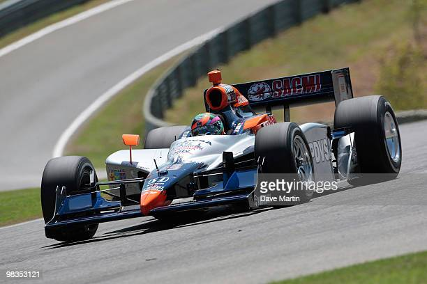 J Viso of Veneuela driver of the KV Racing Technology Dallara Honda races through turn one during practice for the IRL IndyCar Series Grand Prix of...