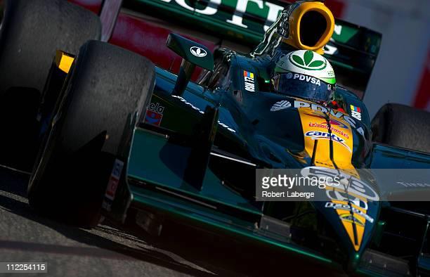E J Viso of Venezuela driver of the KV Racing Technology Lotus Dallara Honda races during practice for the IndyCar Series Toyota Grand Prix of Long...