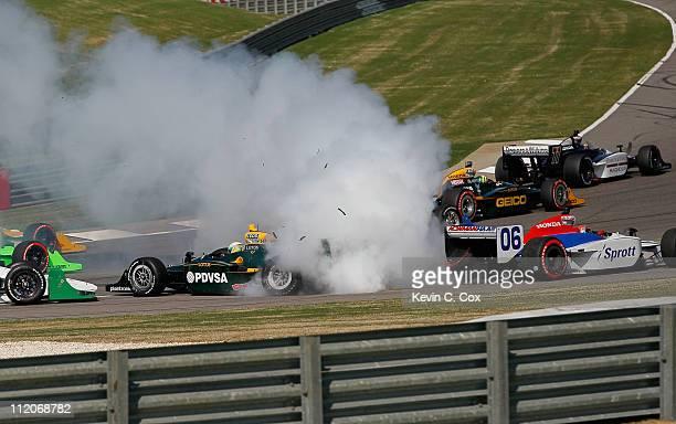 J Viso of Venezuela driver of the KV RacingTechnologyLotus Dallara Honda and James Hinchcliffe of Canada driver of the Newman/Haas Racing Dallara...