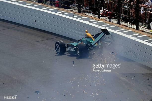 J Viso of Venezuela driver of the Lotus KV Racing Technologies Dallara Honda crashes in to the wall during the IZOD IndyCar Series Indianapolis 500...