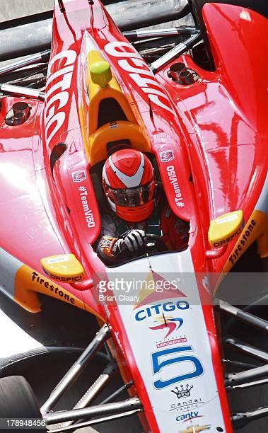 J Viso of Venezuela driver of the Team Venezuala/Andretti Autosport/HVM Chevrolet Dallara drives his car during for practice for the Grand Prix of...