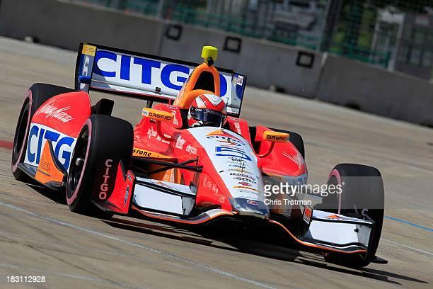 J Viso of Venezuela driver of the Team Venezuala/Andretti Autosport/HVM Chevrolet Dallara drives during practice for the IZOD IndyCar Series Shell...