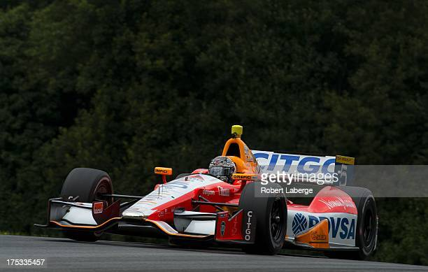E J Viso of Venezuela driver of the Team Venezuela PDVSA Citgo Chevrolet Dallara during practice for the IZOD IndyCar Series Honda Indy 200 on August...
