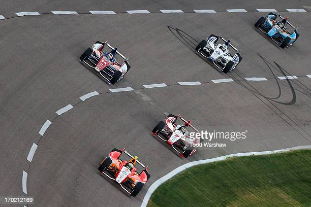 J Viso of Venezuela driver of the Team Venezuela PDVSA/Andretti Autosport Chevrolet leads a pack of cars during the IZOD IndyCar Series Firestone 550...