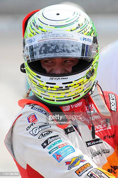 J Viso of Venezuela driver of the Team Venezuela PDVSA/Andretti Autosport Chevrolet looks on from the grid during qualifying for the IZOD IndyCar...