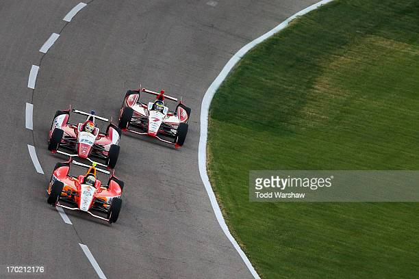 J Viso of Venezuela driver of the Team Venezuela PDVSA/Andretti Autosport Chevrolet races Justin Wilson of England driver of the Dale Coyne Racing...