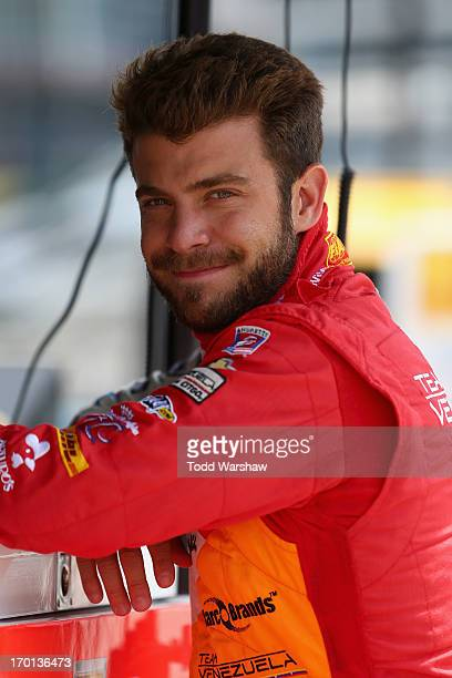 J Viso of Venezuela driver of the Team Venezuela PDVSA/Andretti Autosport Chevrolet stands on the grid during qualifying for the IZOD IndyCar Series...