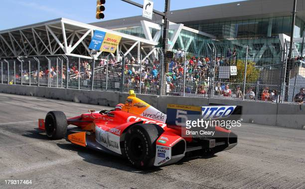 J Viso of Venezuela driver of the Team Venezuela/Andretti Autosport/HVM Chevrolet Dallara drives down the frontstretch during the Grand Prix of...
