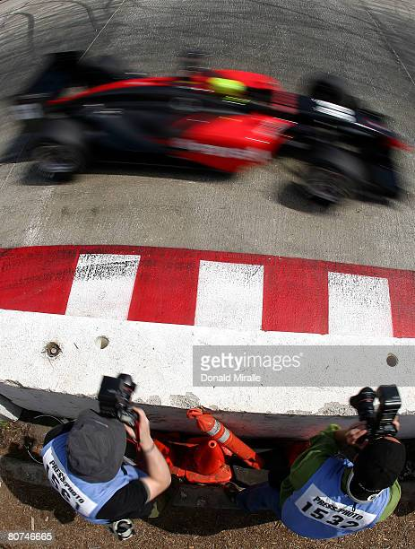E J Viso of Venezuela drives the PDVSA HVM Racing DP01 Ford Cosworth past photographers during practice for the ChampCar World Series Toyota Grand...