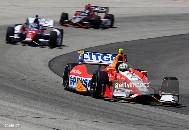 J Viso of Venezuela drives the Team Venezuela PDVSA Citgo Chevrolet ahead of a goup of cars during practice for the Milwaukee IndyFest at the...