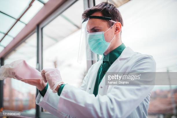 visor as a medical protection from virus - helmet visor stock pictures, royalty-free photos & images