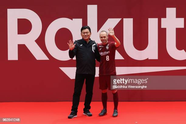 Vissel Kobe new player Andres Iniesta and Rakuten CEO HIroshi Mikitani pose for photographs during the fan meeting at Noevir Stadium Kobe on May 26...