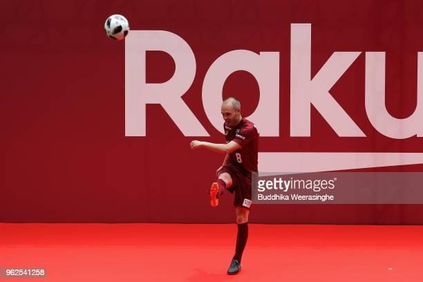 Vissel Kobe new player Andres Iniesta kicks the ball toward fans during the fan meeting at Noevir Stadium Kobe on May 26 2018 in Kobe Hyogo Japan