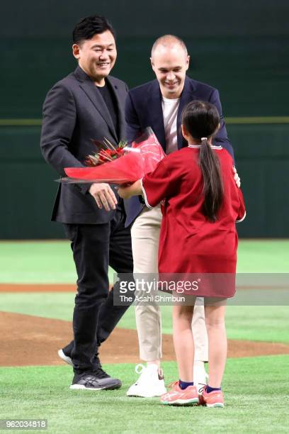 Vissel Kobe new signing Andres Iniesta receives a flower bouquet prior to the professional baseball game between Rakuten Golden Eagles and Orix...