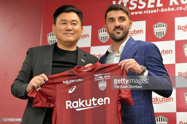 Vissel Kobe new signing David Villa and Rakuten CEO Hiroshi Mikitani pose for photographs during a press conference at the Noevir Stadium Kobe on...
