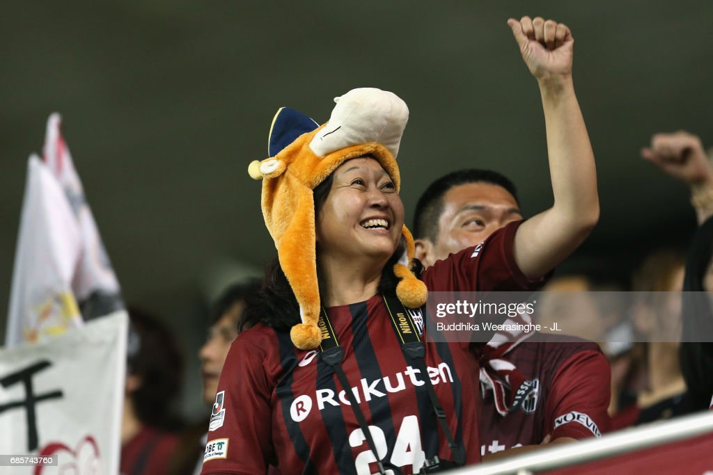 A Vissel Kobe supporter celebrates her team's first goal during the J.League J1 match between Vissel Kobe and FC Tokyo at Noevir Stadium Kobe on May 20, 2017 in Kobe, Hyogo, Japan.